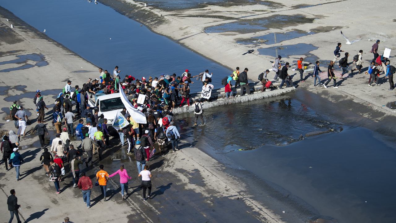 <div class='meta'><div class='origin-logo' data-origin='Creative Content'></div><span class='caption-text' data-credit='Pedro Pardo/AFP/Getty Images'>A group of Central American migrants crosses the almost dry riverbed of the Tijuana River in an attempt to get to El Chaparral port of entry in Tijuana, November 25, 2018.</span></div>
