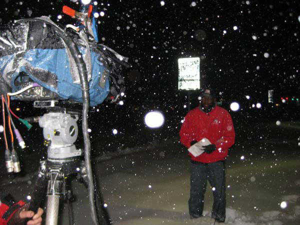 <div class='meta'><div class='origin-logo' data-origin='none'></div><span class='caption-text' data-credit='KTRK Photo'>Tracy Clemons covering the snow in Charlottesville, Va. in 2009</span></div>