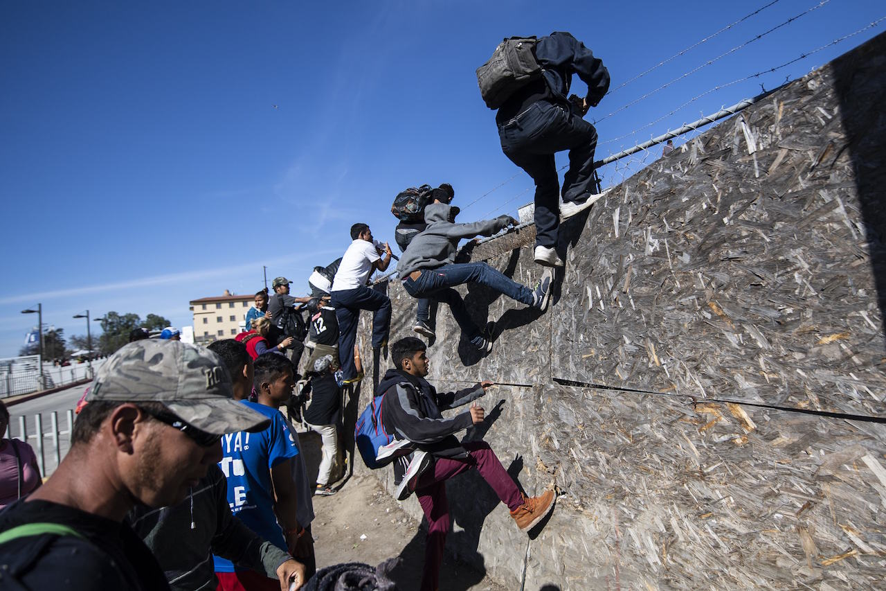 <div class='meta'><div class='origin-logo' data-origin='AP'></div><span class='caption-text' data-credit='Pedro Pardo/AFP/Getty Images'>A group of Central American migrants gets over a fence as they try to reach the US-Mexico border near the El Chaparral border crossing in Tijuana, Mexico, on November 25, 2018.</span></div>