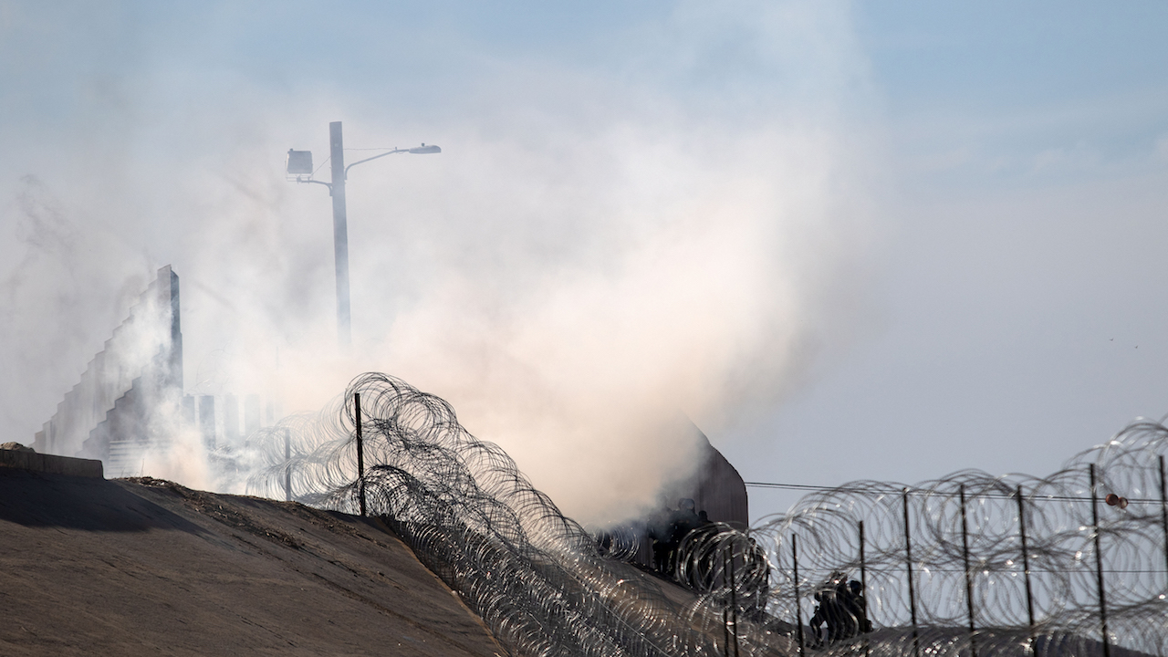 <div class='meta'><div class='origin-logo' data-origin='AP'></div><span class='caption-text' data-credit='Guillermo Arias/AFP/Getty Images'>Tear gas thrown by the US Border Patrol to disperse migrants after an alleged verbal dispute is seen near the El Chaparral border crossing in Tijuana, November 25, 2018.</span></div>