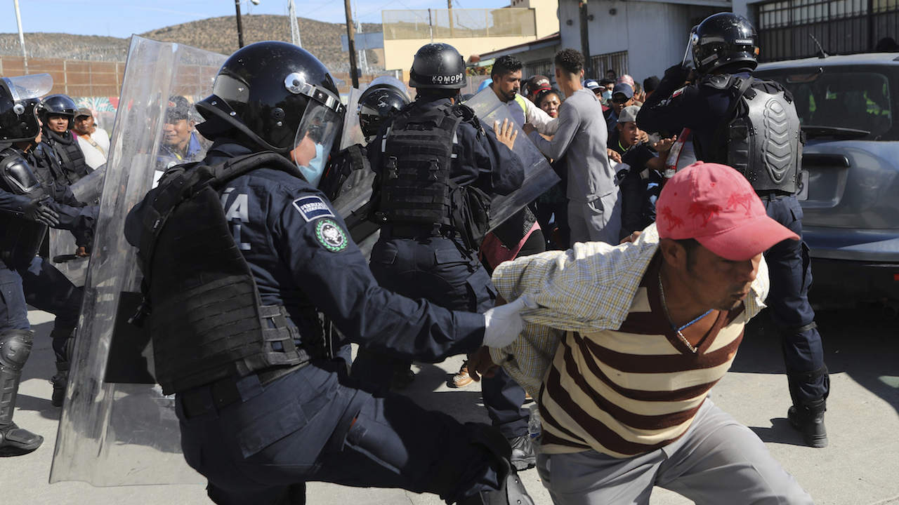 <div class='meta'><div class='origin-logo' data-origin='AP'></div><span class='caption-text' data-credit='AP Photo/Rodrigo Abd'>Migrants try to push past Mexican police on the Mexico-U.S. border at the Chaparral crossing in Tijuana, Mexico, Sunday, Nov. 25, 2018, as they try to reach the U.S.</span></div>