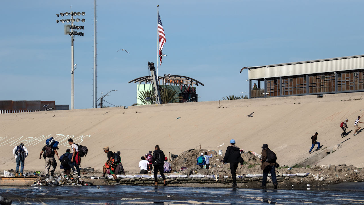 <div class='meta'><div class='origin-logo' data-origin='AP'></div><span class='caption-text' data-credit='Guillermo Arias/AFP/Getty Images'>Central American migrants -mostly from Honduras- cross the shallow concrete waterway of the bordering Tijuana River as they try to reach the El Chaparral border crossing.</span></div>