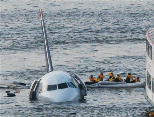 "<div class=""meta image-caption""><div class=""origin-logo origin-image none""><span>none</span></div><span class=""caption-text"">Passengers in an inflatable raft move away from an Airbus 320 US Airways aircraft that has gone down in the Hudson River in New York. (AP Photo/ Bebeto Matthews)</span></div>"