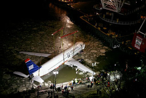 "<div class=""meta image-caption""><div class=""origin-logo origin-image none""><span>none</span></div><span class=""caption-text"">The wreckage of US Airways Flight 1549 is lifted from the waters of lower Manhattan Saturday, Jan. 17, 2009, in New York. (AP Photo/ Craig Ruttle)</span></div>"