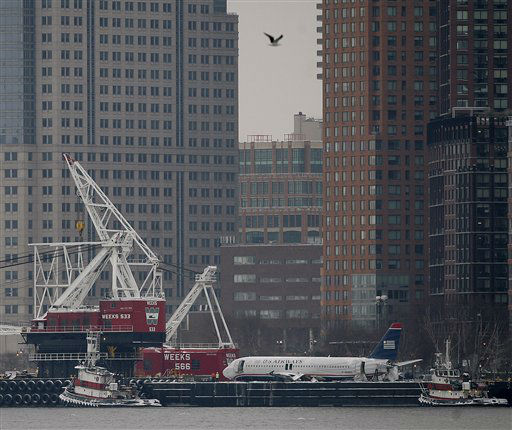 "<div class=""meta image-caption""><div class=""origin-logo origin-image none""><span>none</span></div><span class=""caption-text"">The wreckage of US Airways Flight 1549 sits on a barge after being lifted out of the Hudson River at the southern tip of Manhattan as seen from Jersey City. (AP Photo/ Rich Schultz)</span></div>"