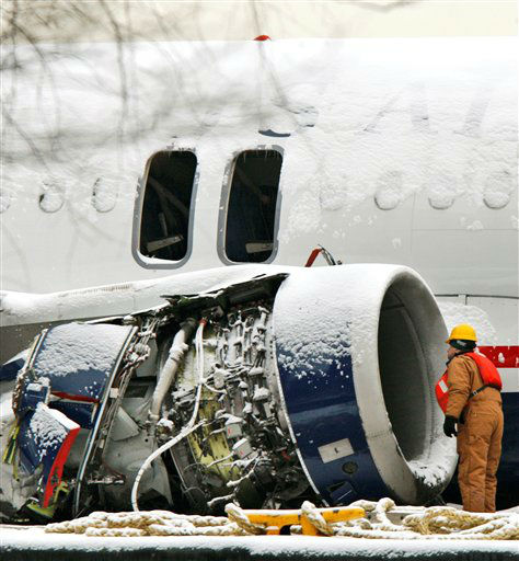"<div class=""meta image-caption""><div class=""origin-logo origin-image none""><span>none</span></div><span class=""caption-text"">A worker looks into the damaged right engine of the US Airways Airbus A320 that made an emergency landing in the Hudson River. (AP Photo/ Kathy Willens)</span></div>"