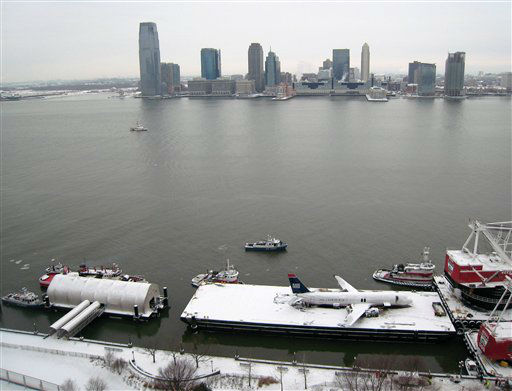 "<div class=""meta image-caption""><div class=""origin-logo origin-image none""><span>none</span></div><span class=""caption-text"">With Jersey City in the background, a crippled US Airways Flight 1549 rests on a barge on the Hudson River in New York, Sunday, Jan. 18, 2009. (AP Photo/ PH PH**NY** PS**NY** JJP**NY**)</span></div>"