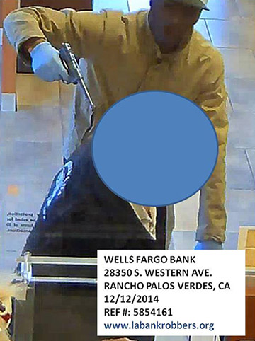 """One of the three suspects in a group nicknamed """"Two Guys and A Girl Bandits"""" shown in surveillance video from Dec. 12, 2014."""