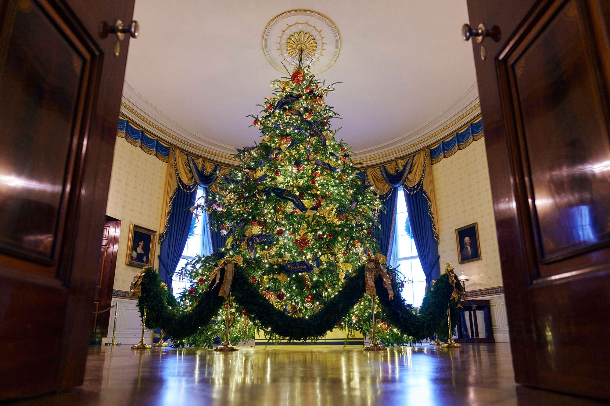<div class='meta'><div class='origin-logo' data-origin='none'></div><span class='caption-text' data-credit='Carolyn Kaster/AP Photo'>The official White House Christmas tree is seen in the Blue Room during the 2018 Christmas Press Preview at the White House in Washington, Monday, Nov. 26, 2018.</span></div>