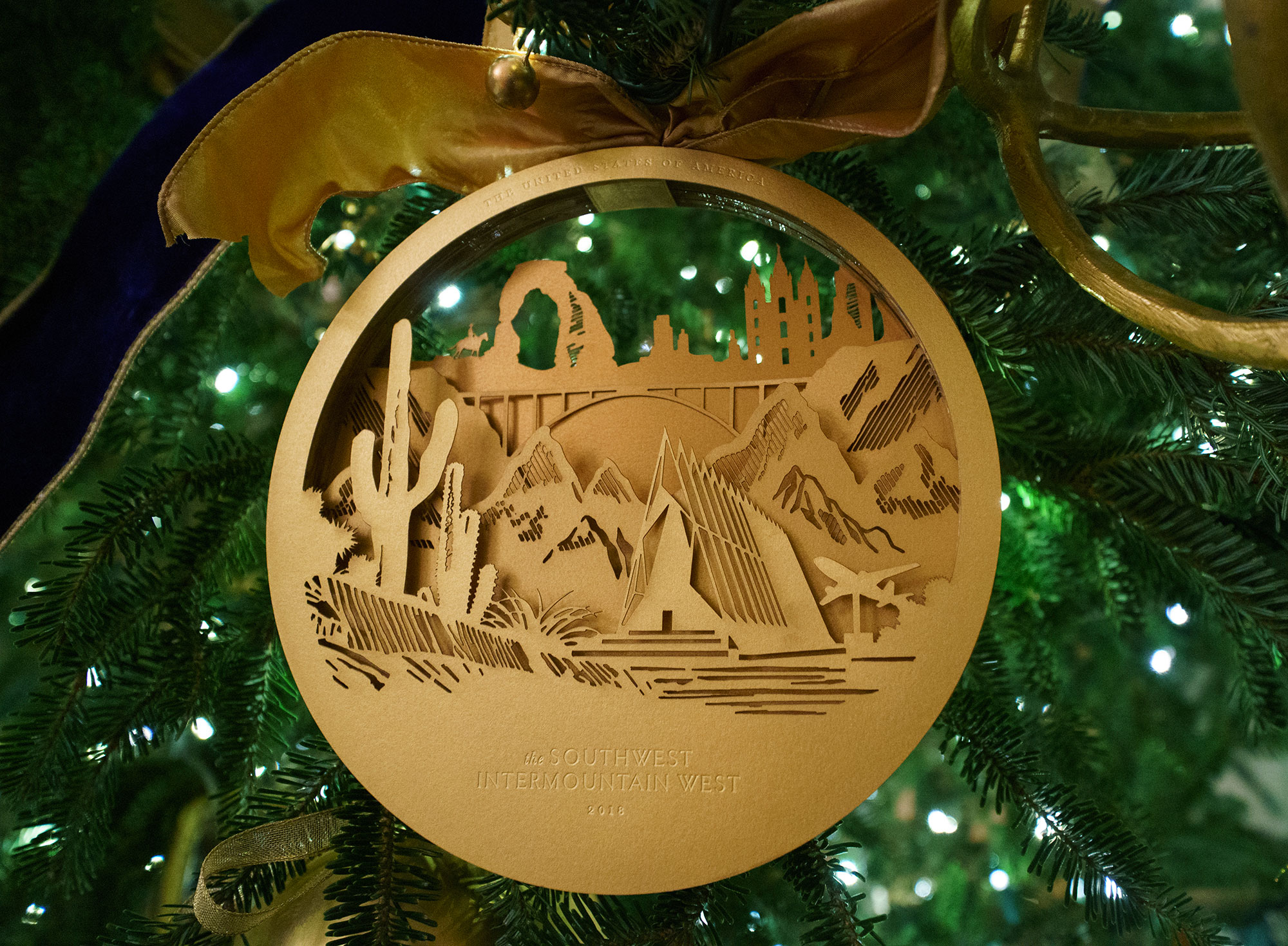 <div class='meta'><div class='origin-logo' data-origin='none'></div><span class='caption-text' data-credit='Carolyn Kaster/AP Photo'>An ornament with images of the Southwest and the Intermountain West hangs on a tree in the East Room to highlight the diversity and ingenuity of American architecture and design.</span></div>