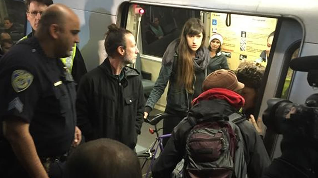 """<div class=""""meta image-caption""""><div class=""""origin-logo origin-image """"><span></span></div><span class=""""caption-text"""">Protesters at the Montgomery St. BART station holding up a westbound train on Friday, Jan. 16, 2015. (@amyhollyfield)</span></div>"""