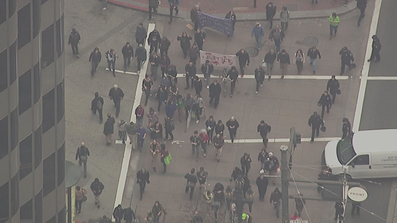 """<div class=""""meta image-caption""""><div class=""""origin-logo origin-image """"><span></span></div><span class=""""caption-text"""">SKY7 HD following BART protesters as they march along Market St. in San Francisco on Friday, Jan. 16, 2015. (KGO)</span></div>"""