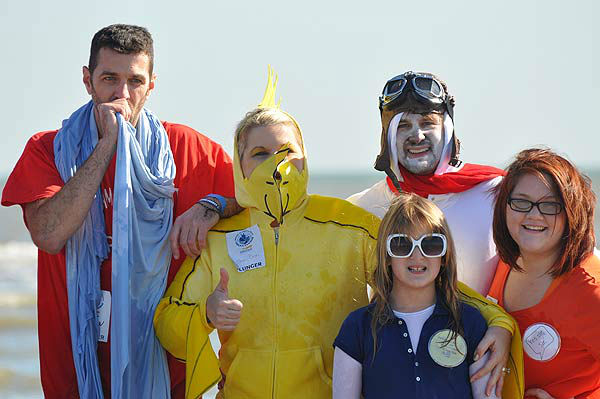 """<div class=""""meta image-caption""""><div class=""""origin-logo origin-image """"><span></span></div><span class=""""caption-text"""">More than 200 'plungers' were freezin' for a reason at the 2014 Polar Plunge in Galveston, Texas, on Saturday, Jan. 18. (KTRK Photo)</span></div>"""