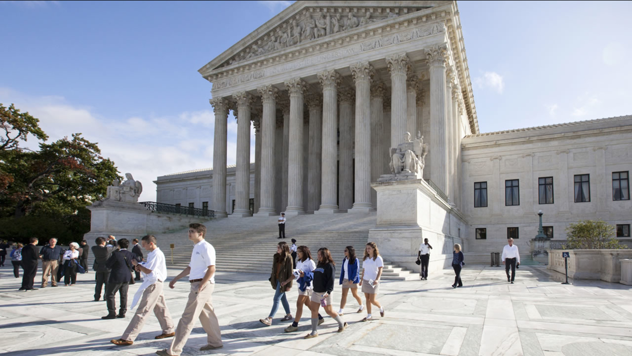 Visitors to the Supreme Court in Washington, Tuesday, Oct. 14, 2014, as it begins the second week of its new term. (AP Photo)