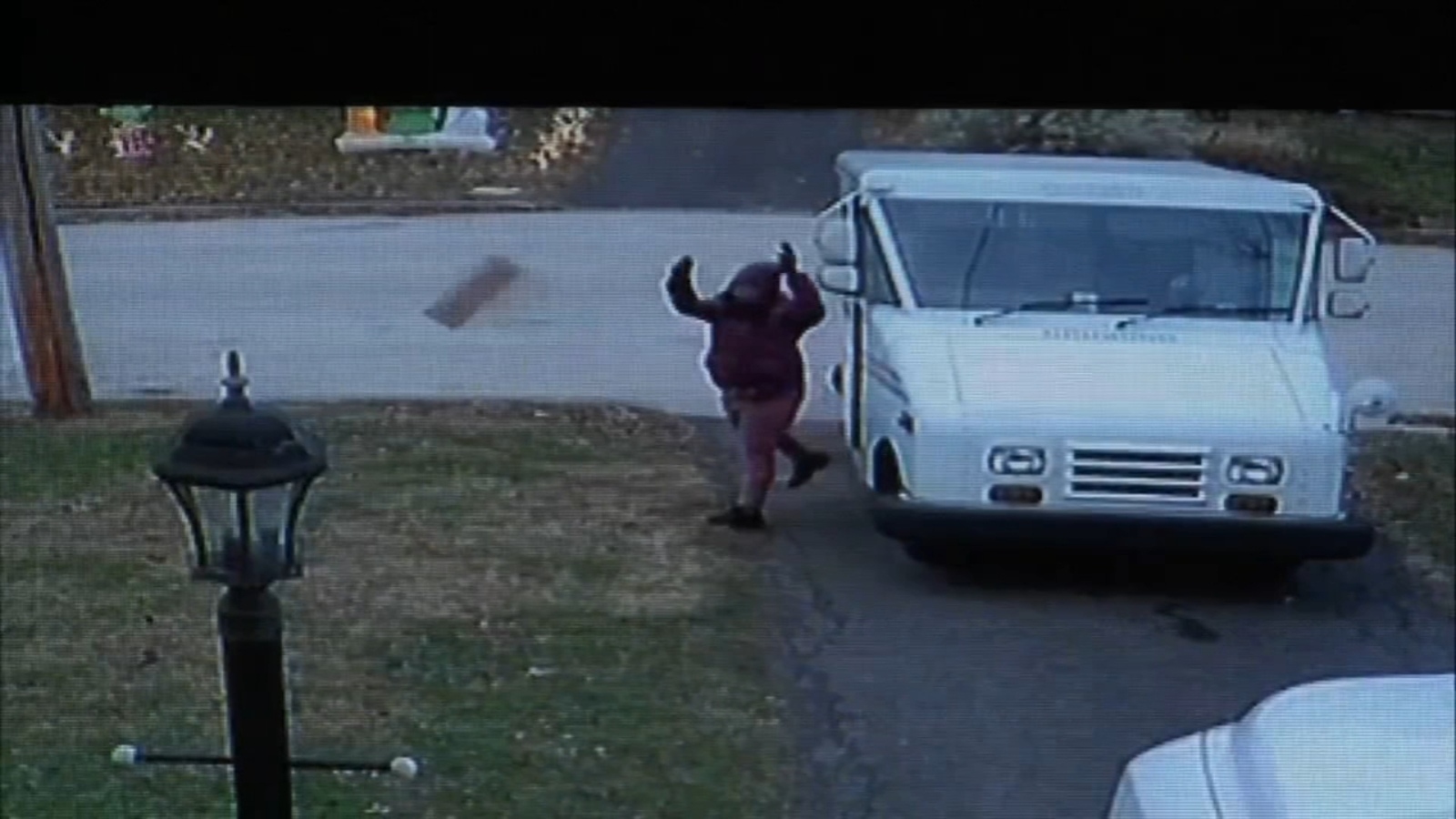 13d22722bcbc9 Caught on camera  Postal worker throws package from truck onto lawn ...