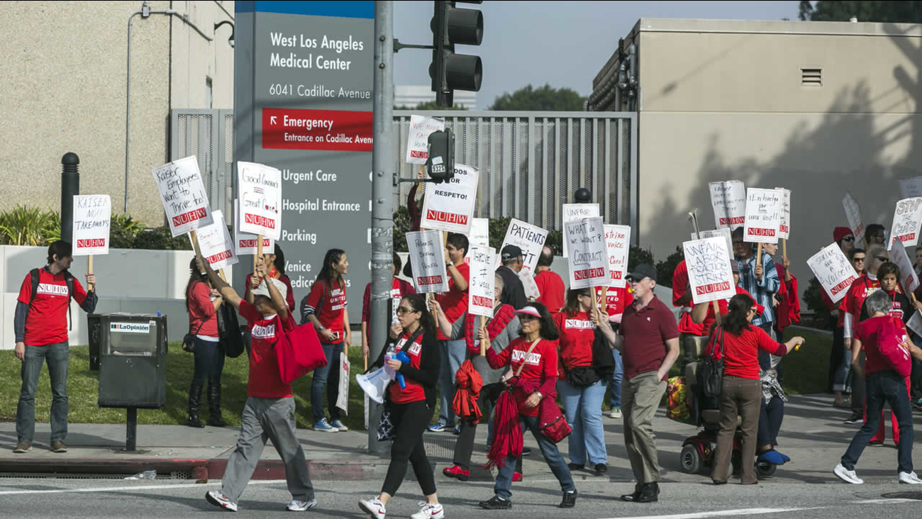 Kaiser Permanente mental health professionals rally outside the Kaiser Permanente West Los Angeles Medical Center in Los Angeles Monday, Jan. 12, 2015. (AP Photo/Damian Dovarganes)