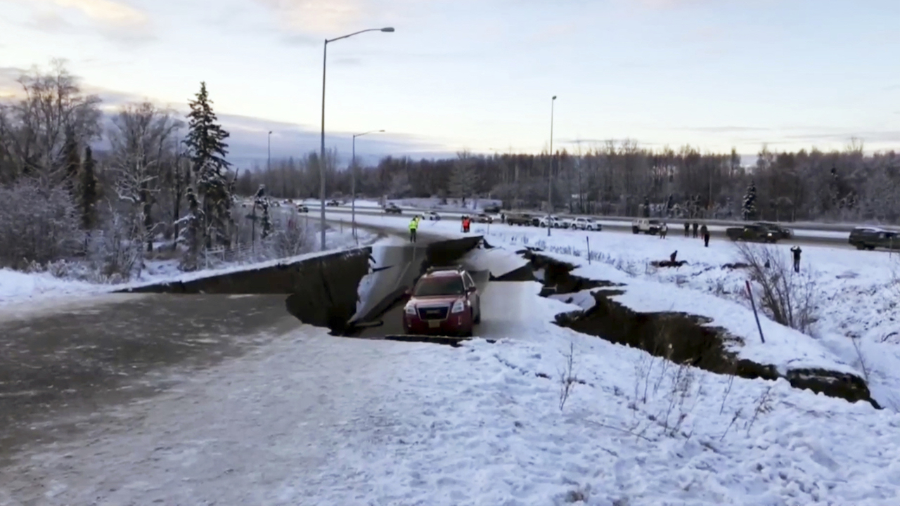 <div class='meta'><div class='origin-logo' data-origin='AP'></div><span class='caption-text' data-credit='AP Photo'>A car is trapped on a collapsed section of the offramp in Anchorage, Friday, Nov. 30, 2018.</span></div>