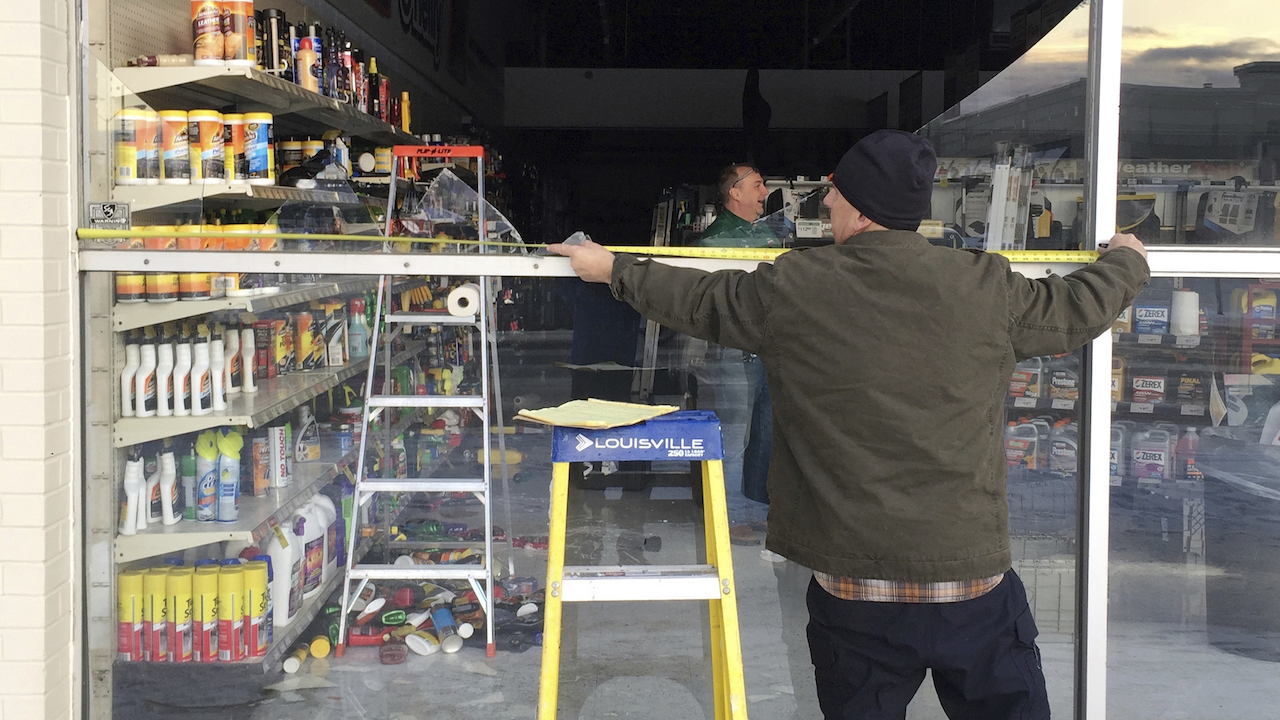 <div class='meta'><div class='origin-logo' data-origin='AP'></div><span class='caption-text' data-credit='AP Photo/Mike Dinneen'>Dennis Keeling measures for a broken window at an auto parts store in Anchorage, on Friday, Nov. 30, 2018.</span></div>