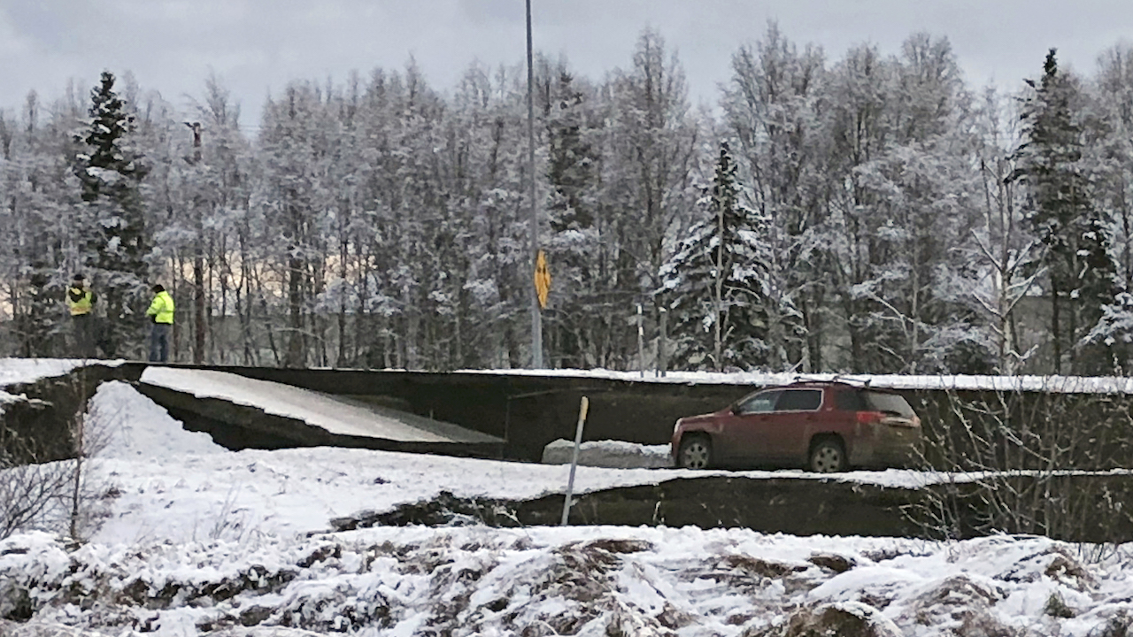 <div class='meta'><div class='origin-logo' data-origin='AP'></div><span class='caption-text' data-credit='AP Photo/Dan Joling'>A car is trapped on a collapsed section of the offramp off of Minnesota Drive in Anchorage, Friday, Nov. 30, 2018.</span></div>