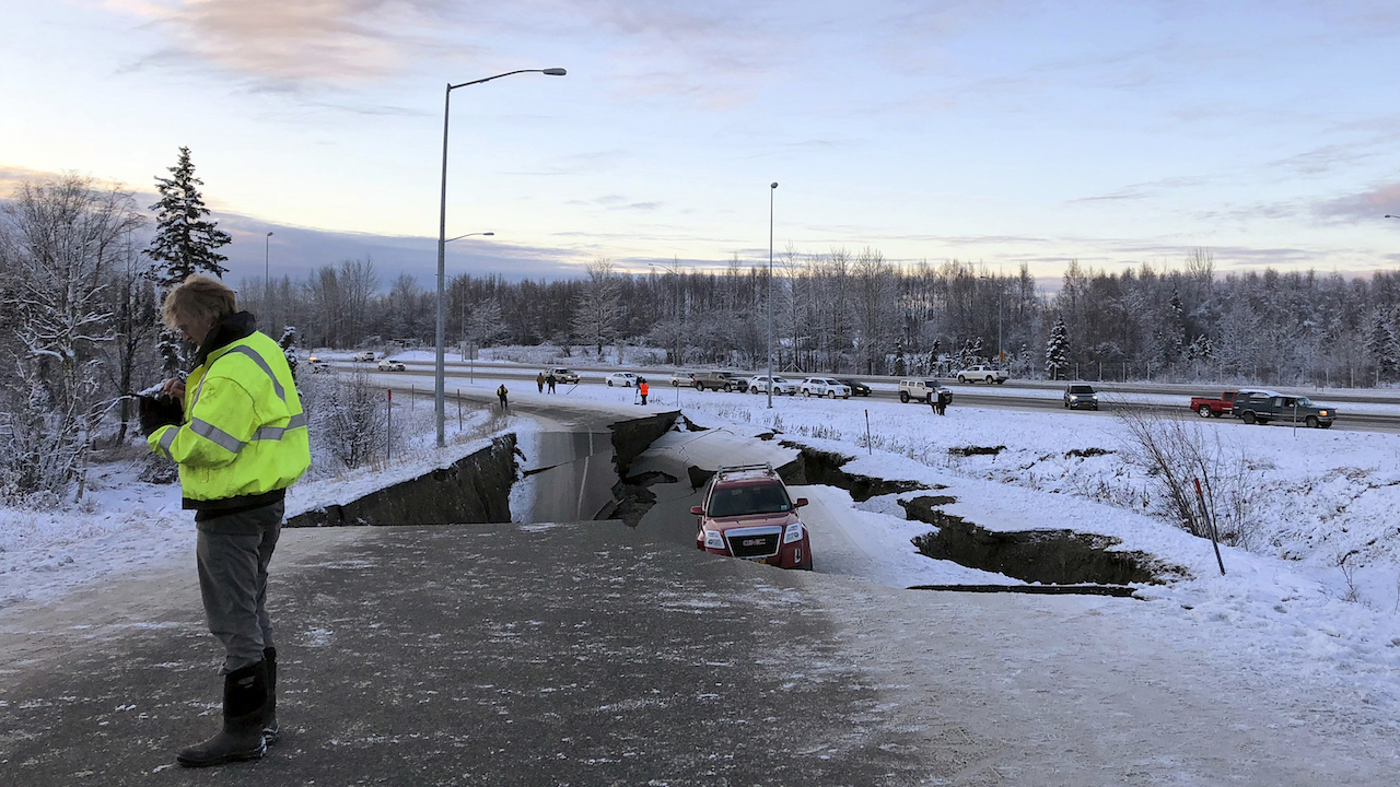<div class='meta'><div class='origin-logo' data-origin='AP'></div><span class='caption-text' data-credit='AP Photo/Dan Joling'>A car is trapped on a collapsed section of the offramp of Minnesota Drive in Anchorage, Friday, Nov. 30, 2018.</span></div>