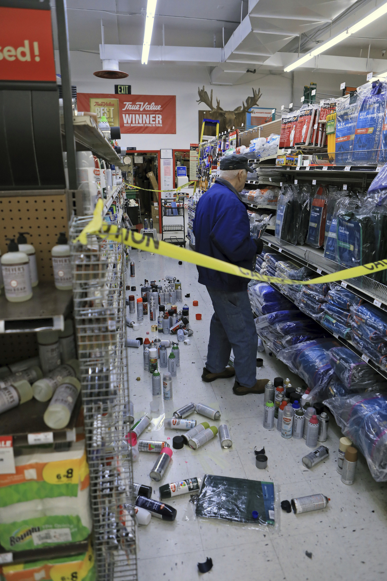 <div class='meta'><div class='origin-logo' data-origin='AP'></div><span class='caption-text' data-credit='AP Photo/Dan Joling'>A customer at Anchorage True Value hardware store shops in the partially cleaned-up paint aisle after an earthquake Friday morning, Nov. 30, 2018, in Anchorage, Alaska.</span></div>