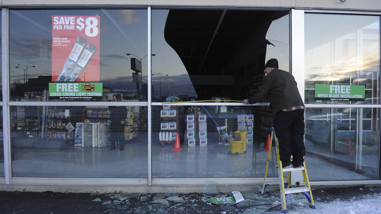 <div class='meta'><div class='origin-logo' data-origin='AP'></div><span class='caption-text' data-credit='AP Photo/Mike Dinneen'>Dennis Keeling, of Instant Services, measures for a broken window at an auto parts store following an earthquake Friday, Nov. 30, 2018, in Anchorage, Alaska.</span></div>