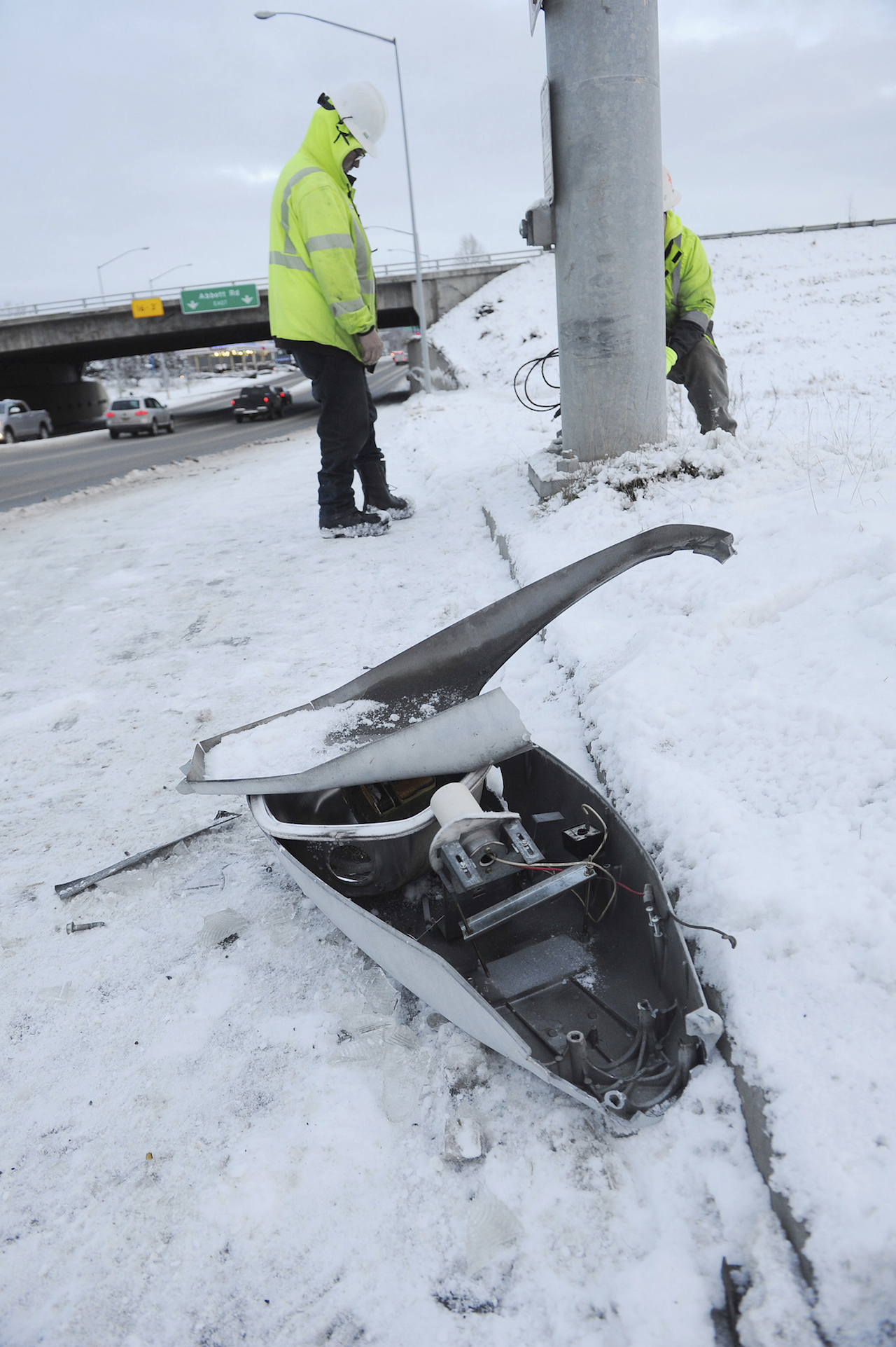 <div class='meta'><div class='origin-logo' data-origin='AP'></div><span class='caption-text' data-credit='AP Photo/Mike Dinneen'>Energy Services North employees prepare to replace a fallen street light in Anchorage, one of the effects of the morning's earthquake which caused damage to the local area.</span></div>