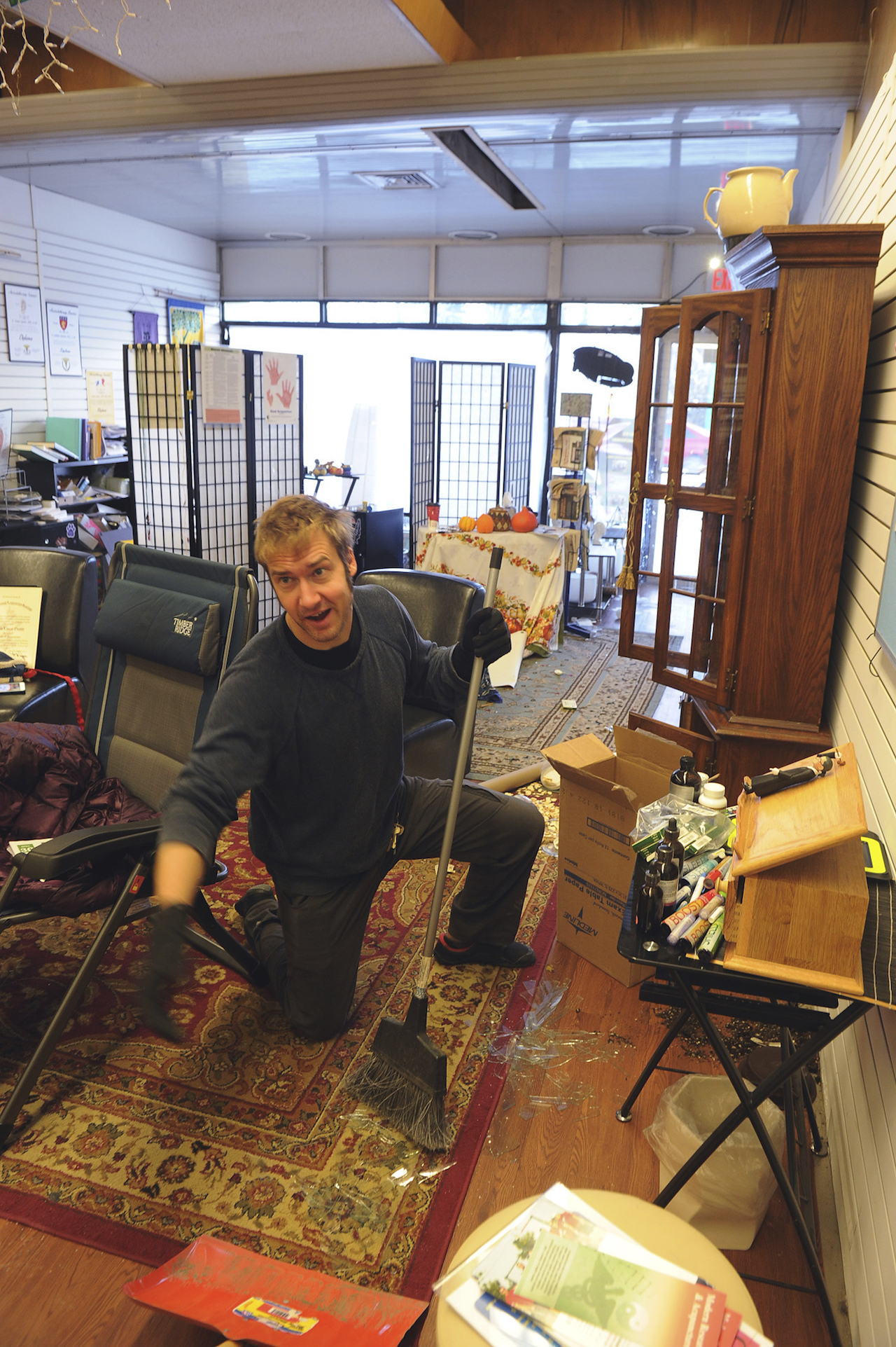 <div class='meta'><div class='origin-logo' data-origin='AP'></div><span class='caption-text' data-credit='AP Photo/Mike Dinneen'>Tristan Covina helps clean up broken glass in the offices of Institute Alaska in Anchorage, Alaska following the morning's earthquake which caused damage to the local area.</span></div>