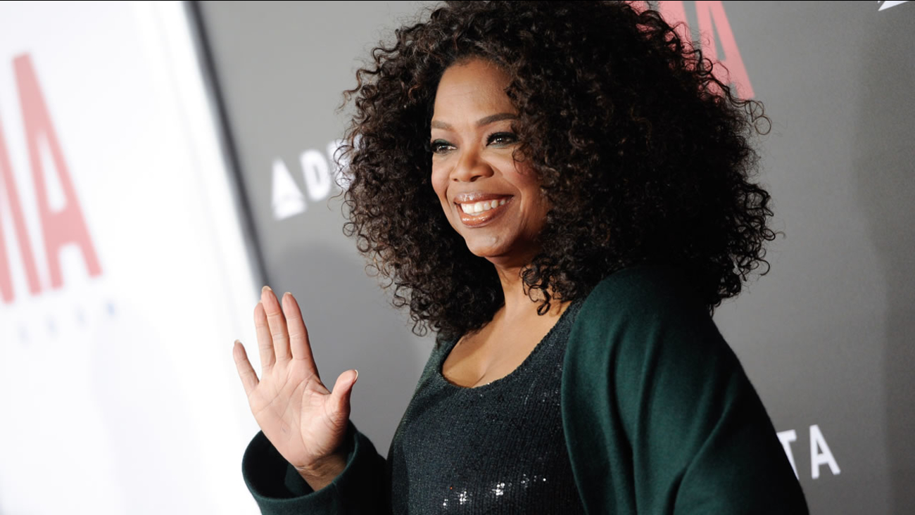 """Producer Oprah Winfrey attends the premiere of """"Selma"""" at the Ziegfeld Theatre on Sunday, Dec. 14, 2014, in New York. (Photo by Evan Agostini/Invision/AP)"""