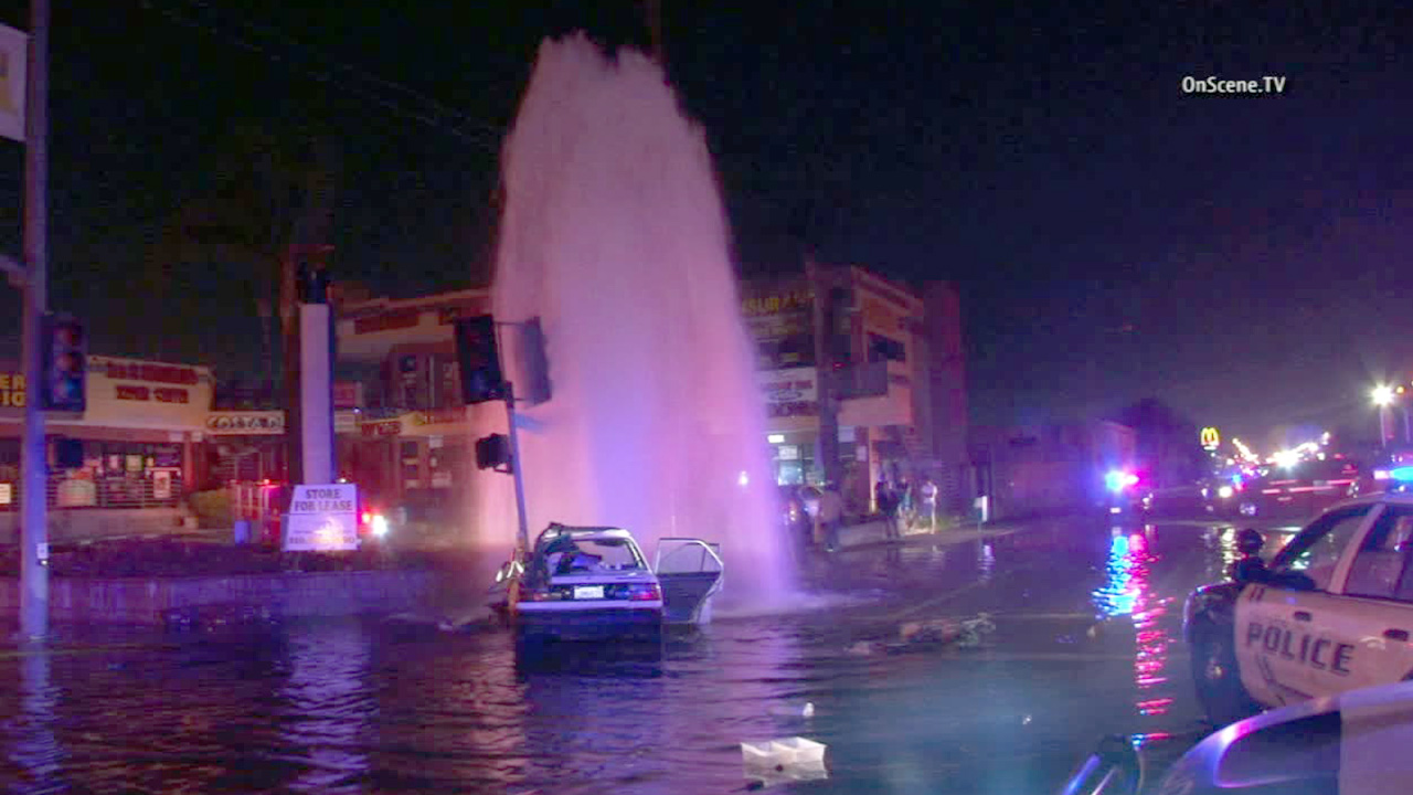 A car crashed into a fire hydrant in Hawthorne, leaving streets flooded on Sunday, Jan. 19, 2015.