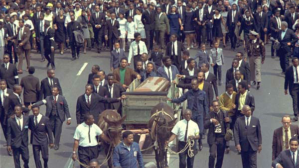 "<div class=""meta image-caption""><div class=""origin-logo origin-image ""><span></span></div><span class=""caption-text"">A brace of plow mules drawing the farm wagon bearing the mahogany casket of Dr. Martin Luther King, Jr., on April 9, 1968. (AP)</span></div>"