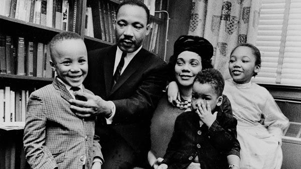 "<div class=""meta image-caption""><div class=""origin-logo origin-image ""><span></span></div><span class=""caption-text"">Dr. Martin Luther King Jr. and his wife, Coretta Scott King, sit with three of their four children in their Atlanta, Ga, home, on March 17, 1963 (AP)</span></div>"