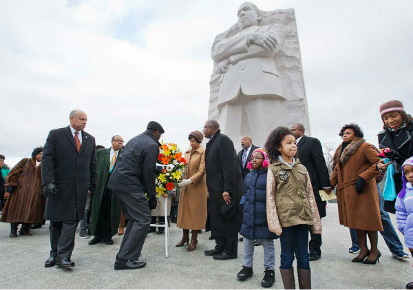 "<div class=""meta image-caption""><div class=""origin-logo origin-image ""><span></span></div><span class=""caption-text"">Homeland Security Secretary Jeh Johnson, left, participates in a wreath laying ceremony at the Martin Luther King, Jr. Memorial, on MLK Day, Monday, Jan. 19, 2015, in Washington. (AP Photo/Jacquelyn Martin)</span></div>"