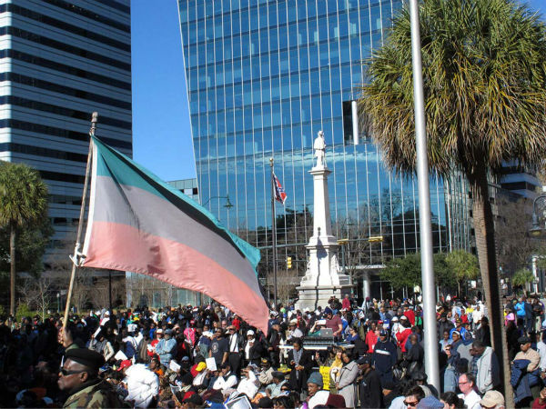 "<div class=""meta image-caption""><div class=""origin-logo origin-image ""><span></span></div><span class=""caption-text"">A crowd listens to speakers at the annual King Day at the Dome rally as the Confederate flag flies on the grounds of the South Carolina Statehouse on Monday, Jan. 19, 2015. (AP Photo/Jeffrey Collins)</span></div>"