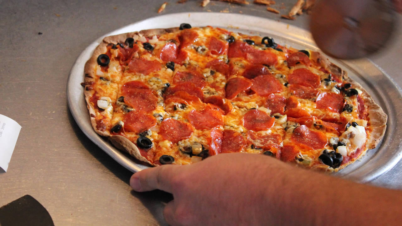 This Oct. 10, 2014 photo provided by the Springfield, Missouri, Convention & Visitors Bureau shows a St. Louis-style pizza.  (AP Photo)