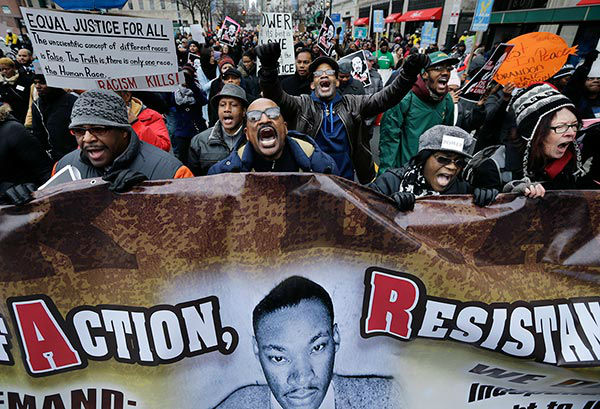 "<div class=""meta image-caption""><div class=""origin-logo origin-image ""><span></span></div><span class=""caption-text"">Dwayne Gilbert, center, of Philadelphia, marches to honor Rev. Martin Luther King Jr., Monday, Jan. 19, 2015, in Philadelphia. (AP Photo/Mel Evans)</span></div>"