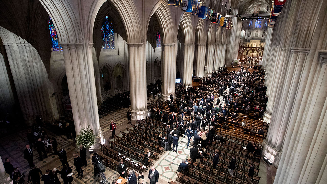 "<div class=""meta image-caption""><div class=""origin-logo origin-image none""><span>none</span></div><span class=""caption-text"">Visitors gather before a State Funeral for former President George H.W. Bush at the National Cathedral, Wednesday, Dec. 5, 2018,  in Washington. (Andrew Harnik, Pool/AP Photo)</span></div>"