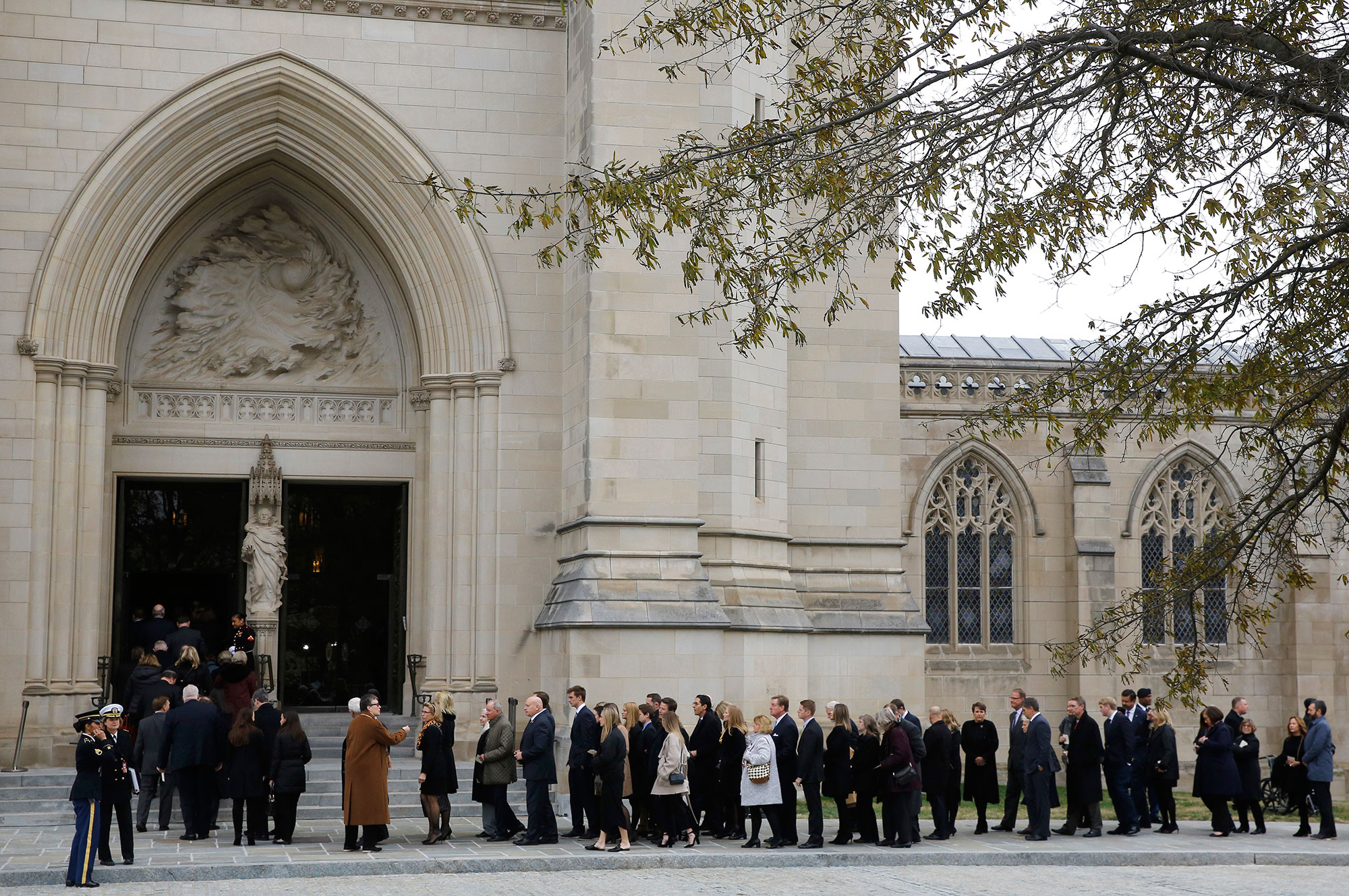 "<div class=""meta image-caption""><div class=""origin-logo origin-image none""><span>none</span></div><span class=""caption-text"">Mourners file into the Washington National Cathedral before the State Funeral for former President George H.W. Bush in Washington, Wednesday, Dec. 5, 2018. (Patrick Semansky/AP Photo)</span></div>"