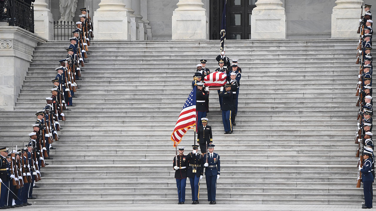 "<div class=""meta image-caption""><div class=""origin-logo origin-image none""><span>none</span></div><span class=""caption-text"">The casket with the remains of former US President George H.W. Bush departs the US Capitol during a State Funeral in Washington, DC, December 5, 2018. (SAUL LOEB/AFP/Getty Images)</span></div>"