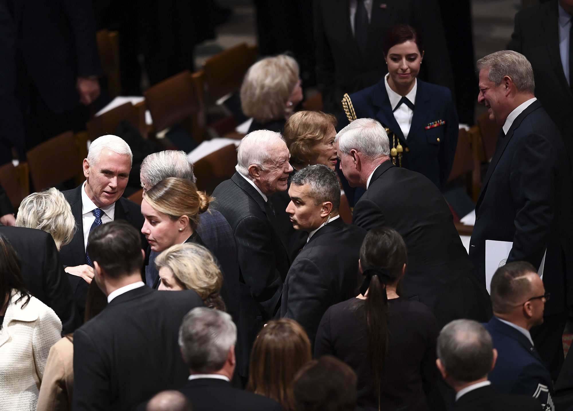 "<div class=""meta image-caption""><div class=""origin-logo origin-image none""><span>none</span></div><span class=""caption-text"">Former US Vice President Al Gore(R) Vice President Mike Pence (L) and former US President Jimmy Carter(C) arrive for the funeral service for former US President George H. W. Bush. (BRENDAN SMIALOWSKI/AFP/Getty Images)</span></div>"