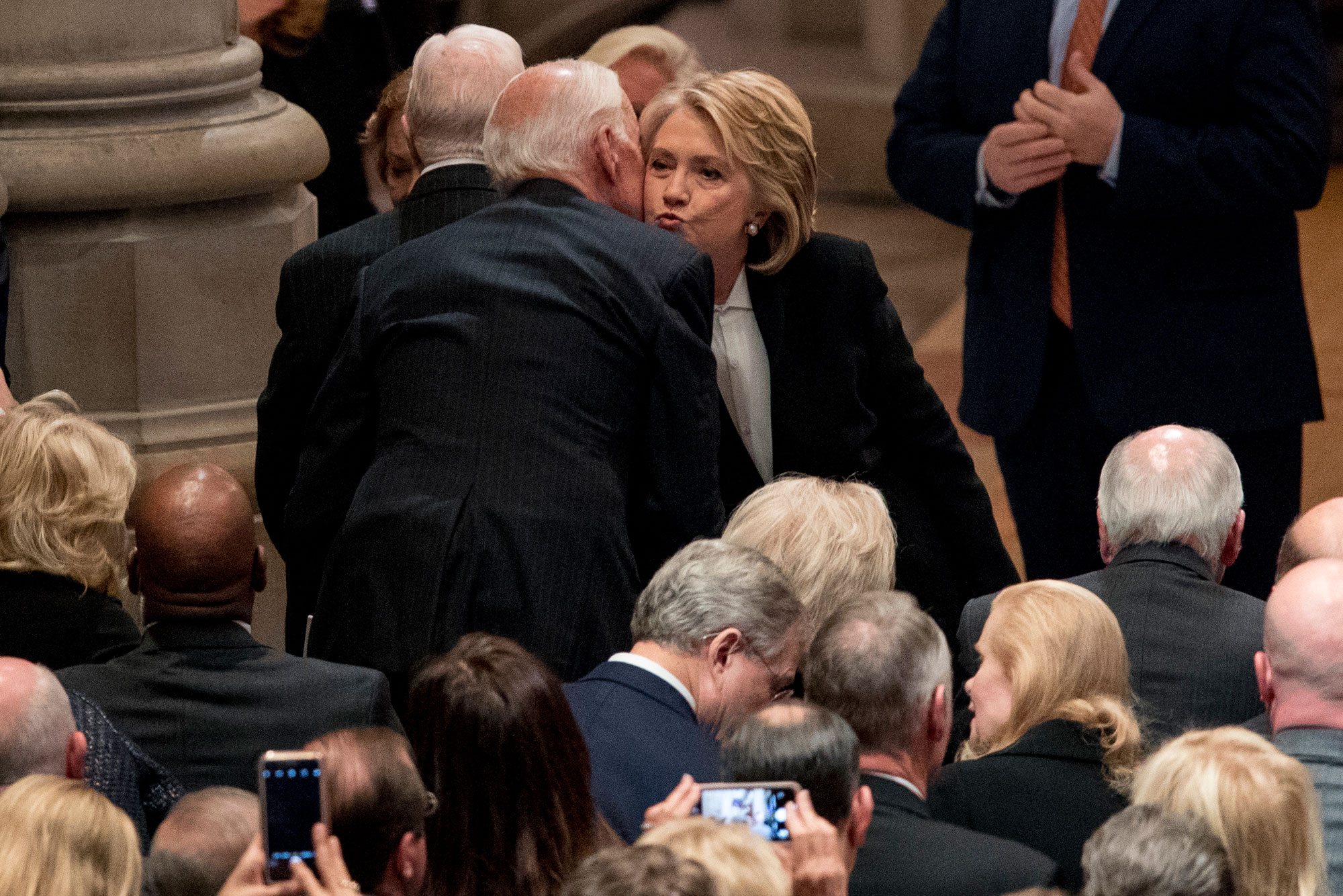 "<div class=""meta image-caption""><div class=""origin-logo origin-image none""><span>none</span></div><span class=""caption-text"">Former Secretary of State Hilary Clinton, right, greets former Vice President Joe Biden, left, before a State Funeral for former President George H.W. Bush. (Andrew Harnik, Pool/AP Photo)</span></div>"