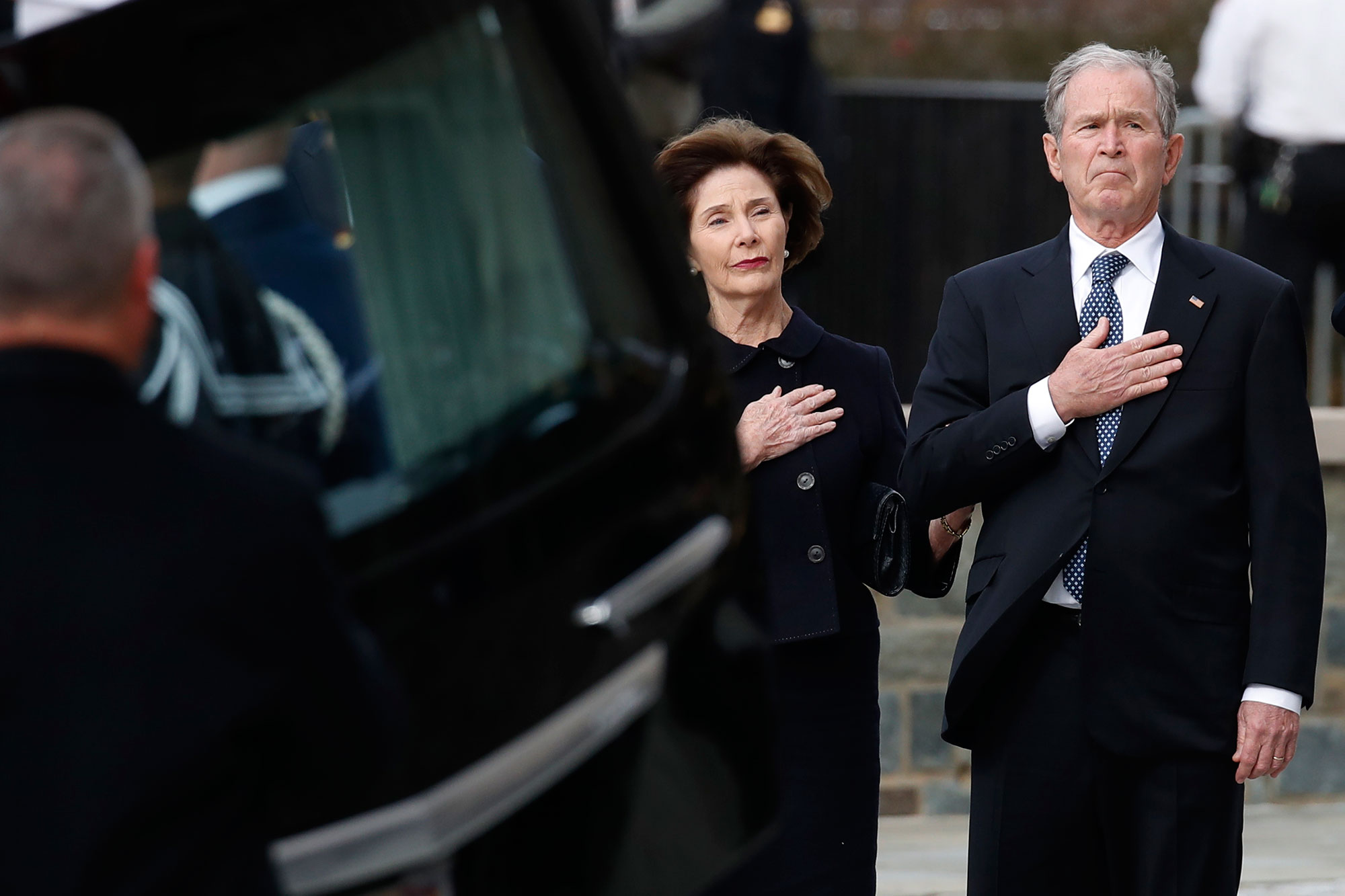 "<div class=""meta image-caption""><div class=""origin-logo origin-image none""><span>none</span></div><span class=""caption-text"">George W. Bush and Laura Bush watch as the flag-draped casket of his father is carried by  joint services military honor guard to a State Funeral in Washington. (Alex Brandon - Pool/Getty Images)</span></div>"