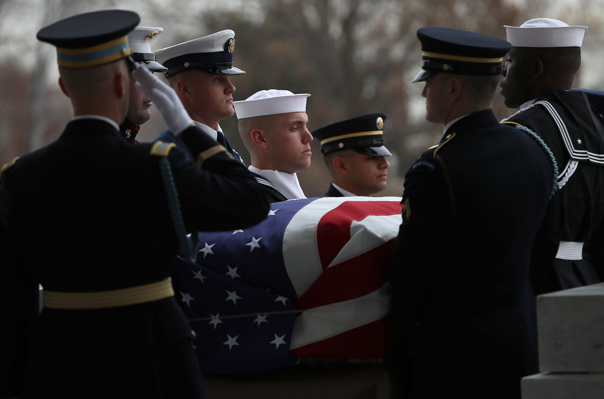 "<div class=""meta image-caption""><div class=""origin-logo origin-image none""><span>none</span></div><span class=""caption-text"">A U.S. military honor guard team carries the flag draped casket of former U.S. President George H. W. Bush from the U.S. Capitol December 5, 2018 in Washington, DC. (Win McNamee/Getty Images)</span></div>"