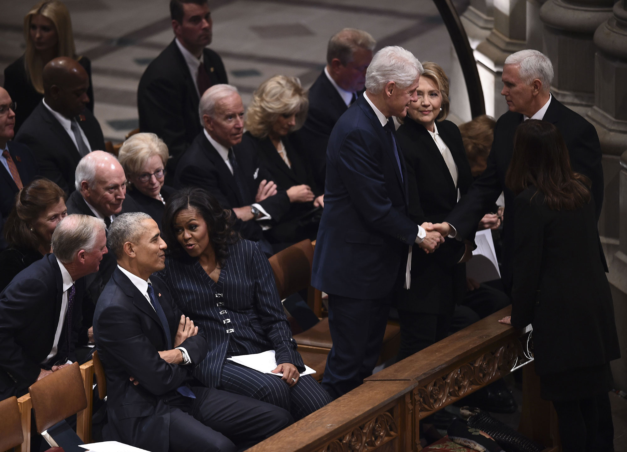 "<div class=""meta image-caption""><div class=""origin-logo origin-image none""><span>none</span></div><span class=""caption-text"">Barack Obama and Michelle Obama speak as Bill Clinton and Hillary Clinton greet Vice President Mike Pence and Karen Pence before the funeral. (BRENDAN SMIALOWSKI/AFP/Getty Images)</span></div>"