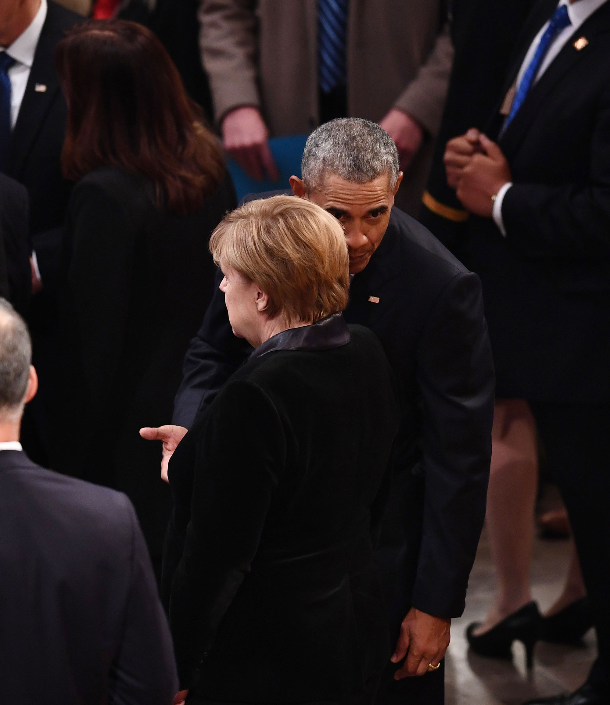 "<div class=""meta image-caption""><div class=""origin-logo origin-image none""><span>none</span></div><span class=""caption-text"">German Chancellor Angela Merkel speaks with former US President Barack Obama as they arrive for the funeral service for former US President George H. W. Bush. (BRENDAN SMIALOWSKI/AFP/Getty Images)</span></div>"