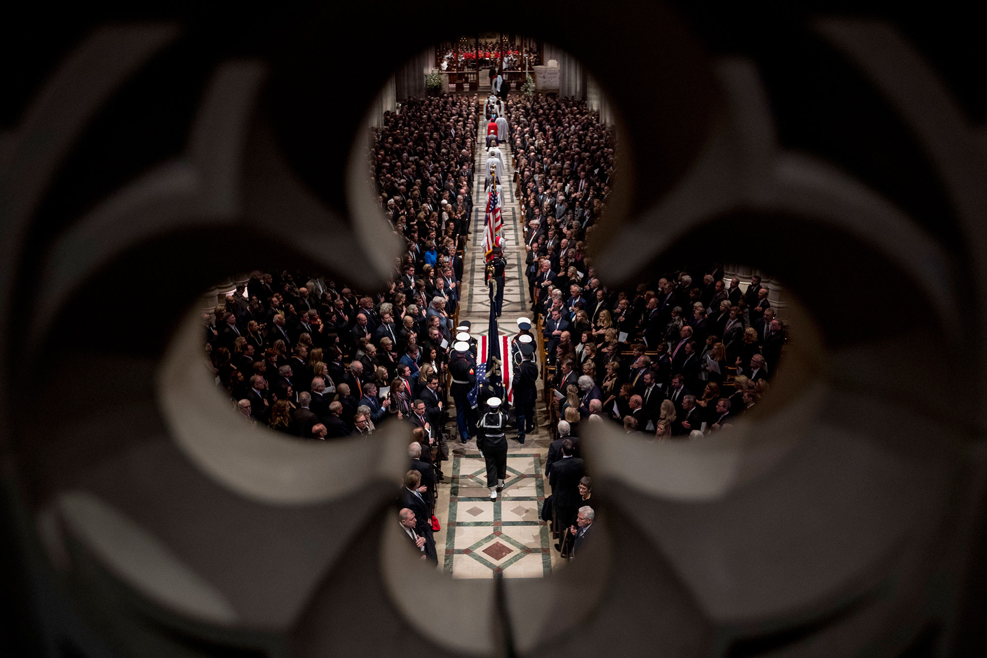 "<div class=""meta image-caption""><div class=""origin-logo origin-image none""><span>none</span></div><span class=""caption-text"">The flag-draped casket of former President George H.W. Bush is arrives carried by a military honor guard during a State Funeral at the National Cathedral. (Andrew Harnik, Pool/AP Photo)</span></div>"