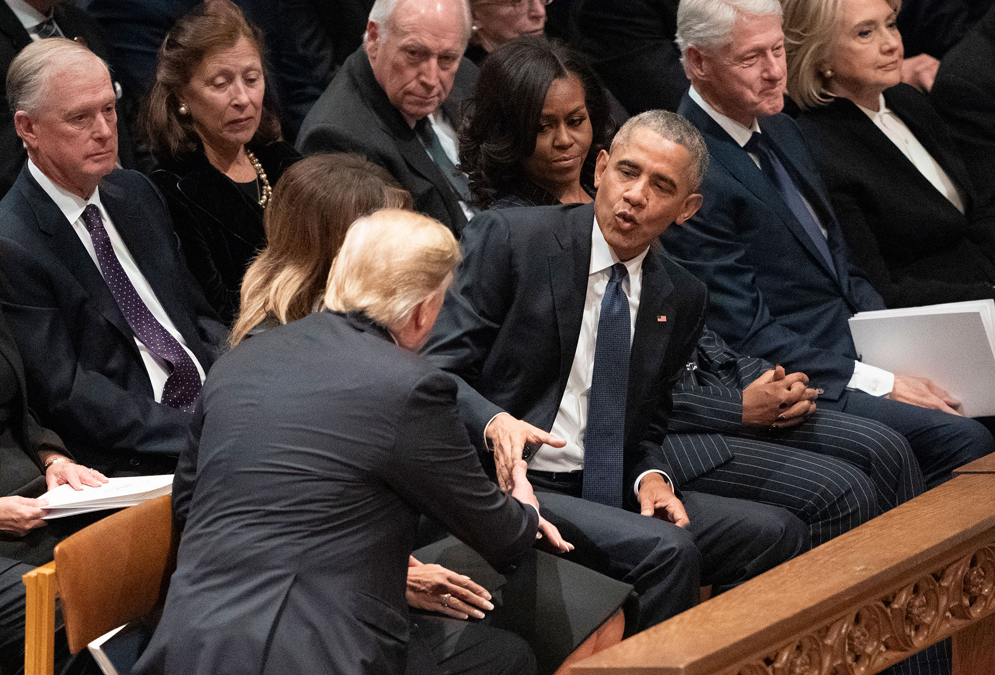 "<div class=""meta image-caption""><div class=""origin-logo origin-image none""><span>none</span></div><span class=""caption-text"">President Donald Trump shakes hands with former President Barack Obama during a State Funeral service for former President George H.W. Bush. (Carolyn Kaster/AP Photo)</span></div>"