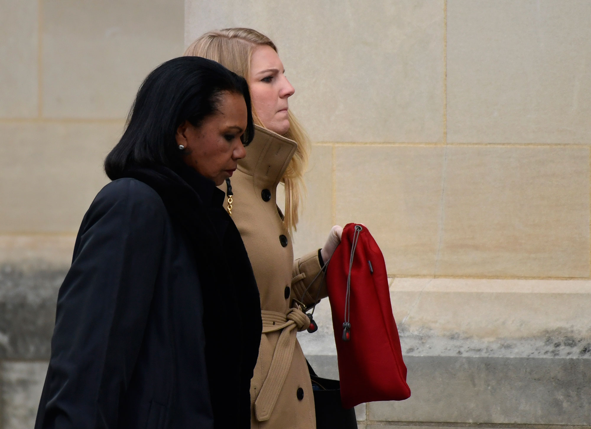 "<div class=""meta image-caption""><div class=""origin-logo origin-image none""><span>none</span></div><span class=""caption-text"">Former Secretary of State Condoleezza Rice, left, arrives for the State Funeral of former President George H.W. Bush. (Susan Walsh/AP Photo)</span></div>"