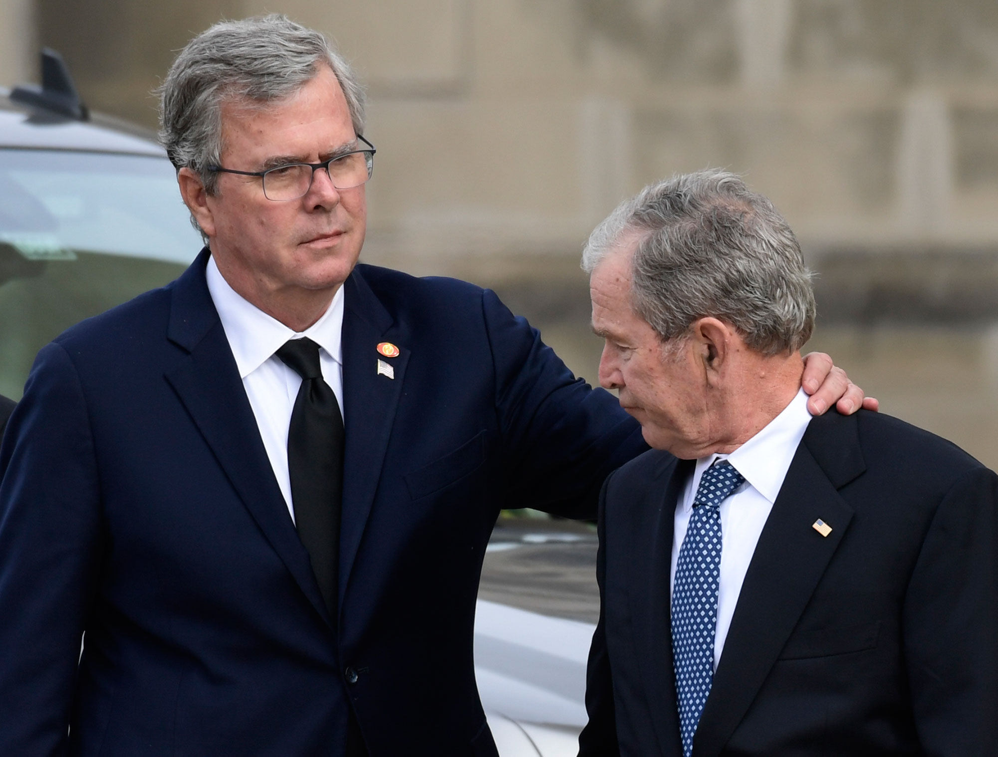 "<div class=""meta image-caption""><div class=""origin-logo origin-image none""><span>none</span></div><span class=""caption-text"">Former Florida Gov. Jeb Bush, left, reaches out to his brother, former President George W. Bush, right, arrive. (Susan Walsh/AP Photo)</span></div>"