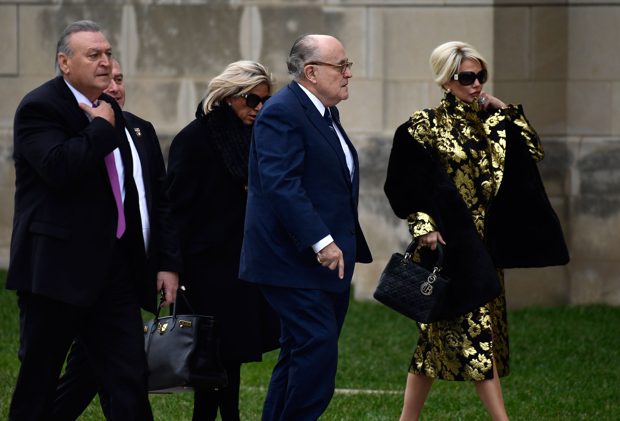 "<div class=""meta image-caption""><div class=""origin-logo origin-image none""><span>none</span></div><span class=""caption-text"">Rudy Guiliani, center, and other guests, arrive for the State Funeral of former President George H.W. Bush at the National Cathedral in Washington, Wednesday, Dec. 5, 2018. (Susan Walsh/AP Photo)</span></div>"